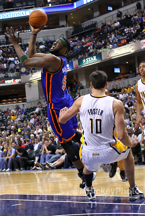 April 10, 2011; Indianapolis, IN, USA; New York Knicks shooting guard Bill Walker (5) takes an off-balance shot as Indiana Pacers center Jeff Foster (10) falls at Conseco Fieldhouse. Mandatory credit: Michael Hickey-US PRESSWIRE