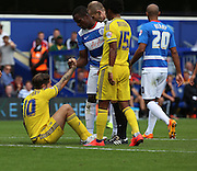 Henri Lansbury (Nottingham Forest midfielder) getting helped up by Nedum Onuoha (QPR defender) after getting fouled during the Sky Bet Championship match between Queens Park Rangers and Nottingham Forest at the Loftus Road Stadium, London, England on 12 September 2015. Photo by Matthew Redman.