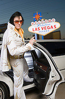Elvis impersonator getting into limo in Las Vegas, Nevada, USA