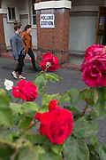 Seen through (the Labour Party symbol) red roses, voters arrive at the polling station on the morning of the UK 2017 general elections outside the polling station at St. Saviour's Parish Hall in Herne Hill, Lambeth, on 8th June 2017, in London, England.