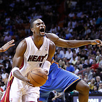16 March 2011: Miami Heat power forward Chris Bosh (1) is fouled during the Oklahoma City Thunder 96-85 victory over the Miami Heat at the AmericanAirlines Arena, Miami, Florida, USA.