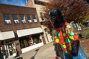 Decorated bear statue among the quaint boutiques and shops in historic Hendersonville, NC