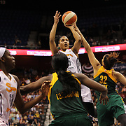 Alyssa Thomas, (top), Connecticut Sun, shoots during the Connecticut Sun Vs Seattle Storm WNBA regular season game at Mohegan Sun Arena, Uncasville, Connecticut, USA. 23rd May 2014. Photo Tim Clayton