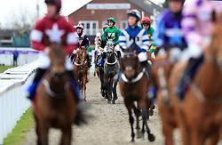 Fixe Le Kap (centre) ridden by jockey Daryl Jacob during Ladies Day of the 2018 Cheltenham Festival at Cheltenham Racecourse.