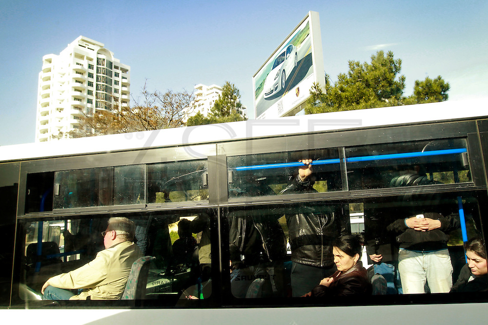 Two Azeri women look trough the bus window. The majority of the population remain poor as a small minority are taking advantages of the rapid economic growth of the country. Azeri GDP grew 41.7% in the first quarter of 2007, possibly the highest of any nation worldwide, as the country economy completed its post-Soviet transition into a major oil based economy.<br /> Baku was awarded the right to host of the first European Games, a multi-sport event.