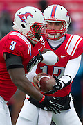 DALLAS, TX - DECEMBER 7: Neal Burcham #12 of the SMU Mustangs hands the ball off to Kevin Pope #3 against the Central Florida Knights on December 7, 2013 at Gerald J. Ford Stadium in Dallas, Texas.  (Photo by Cooper Neill) *** Local Caption *** Neal Burcham; Kevin Pope