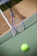 Tennis Rackets And Ball On Court