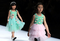 Models present fashion creations designed by Xie Jiaqi during a fashion show titled J.Queen and Little Queen at China Fashion Week in Beijing, capital of China, March 30, 2016. EXPA Pictures © 2016, PhotoCredit: EXPA/ Photoshot/ Li Mingfang<br /> <br /> *****ATTENTION - for AUT, SLO, CRO, SRB, BIH, MAZ, SUI only*****