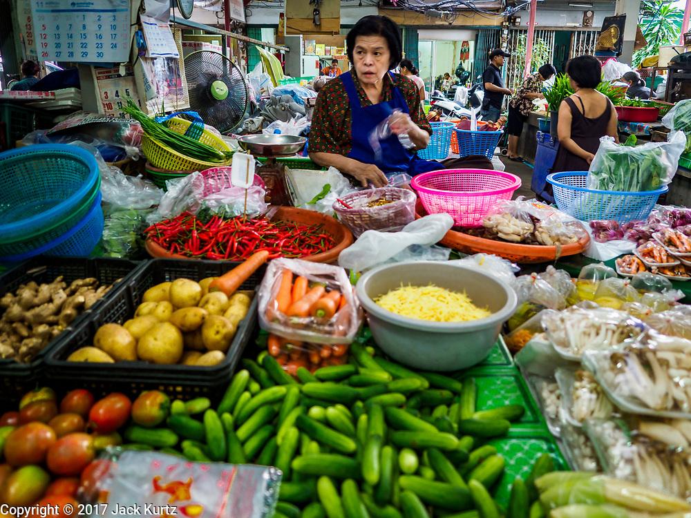 07 NOVEMBER 2017 - BANGKOK, THAILAND: A produce vendor at a local market on Ekkamai Soi 30 in Bangkok.      PHOTO BY JACK KURTZ