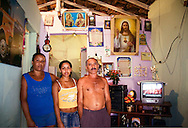 Marciana and her parents. They moved to Rio from Recife in the north when they found it hard to find work. Complexo do Alemao, Rio de Janeiro 2006
