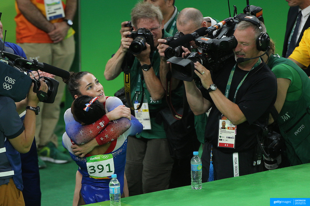 Gymnastics - Olympics: Day 11  Silver medalist Alexandra Raisman of the United States and Gold medalist Simone Biles of the United States celebrate after their performances on the floor exercise during the Apparatus Finals at the Rio Olympic Arena on August 16 , 2016 in Rio de Janeiro, Brazil. (Photo by Tim Clayton/Corbis via Getty Images)