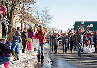 Snow bankings and snow flakes line Main Street for the annual Holiday Parade on Saturday afternoon.  (Karen Bobotas/for the Laconia Daily Sun)