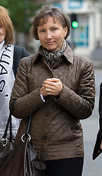© London News Pictures. 02/11/2012. London, UK.  Marina Litvinenko, the wife of  former KGB agent Alexander Litvinenko leaving  Camden Town Hall in London following a pre inquest hearing in to the death of her husband in 2006. Mr Litvinenko, 43, an ex-KGB agent  who fled to Britain in 2000, was allegedly  poisoned by radioactive polonium-210  while drinking tea during a meeting with former security colleagues at the Millennium Hotel in London in 2006. Photo credit: Ben Cawthra/LNP.