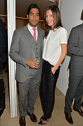 AMANDA SHEPPARD and OMAR MANGALJI at an evening of Fashion, Art & design hosted by Ralph Lauren and Phillips at the new Phillips Gallery, 50 Berkeley Square, London on 22nd October 2014.