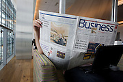 In the British Airways Galleries First lounge at Heathrow Airport's T5 a passenger reads the Business section of a newspaper.