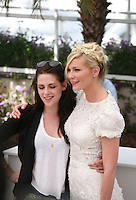 Kristen Stewart, Kirsten Dunst,  at the On The Road photocall at the 65th Cannes Film Festival France. The film is based on the book of the same name by beat writer Jack Kerouak and directed by Walter Salles. Wednesday 23rd May 2012 in Cannes Film Festival, France.