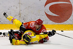 Benoit Gratton of Vienna vs Jan Bercic of Jesenice during ice-hockey match between HK Acroni Jesenice and UPC Vienna Capitals of 25th Round of EBEL League 2011/2012, on November 25, 2011 in Arena Podmezakla, Jesenice, Slovenia. (Photo By Vid Ponikvar / Sportida.com)