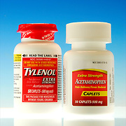 Two bottles of acetaminophen, one Tylenol and other generic brand for minor arthitis, headache, backache, toothache, common cold, muscular aches, menstrual cramps and temporaily reduces fever