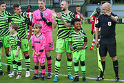 Forest Green Rovers Under 8's Academy players walk out with the team  during the EFL Trophy match between Forest Green Rovers and U21 Southampton at the New Lawn, Forest Green, United Kingdom on 3 September 2019.