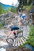 Team X-Fusion descend Thrill Me Kill Me trail in Whistler B.C.
