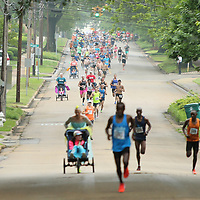Runners fill up Jefferson Street during the Gumtree run in Tupelo Saturday morning.