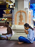 11 DECEMBER 2018 - SINGAPORE:  A man prays at the Sri Sivan Temple in the Geylang neighborhood. The temple was originally built in 1850s in the area that in now Orchard Road. The temple was moved to its current site in Geylang in 1993. The Geylang area of Singapore, between the Central Business District and Changi Airport, was originally coconut plantations and Malay villages. During Singapore's boom the coconut plantations and other farms were pushed out and now the area is a working class community of Malay, Indian and Chinese people. In the 2000s, developers started gentrifying Geylang and new housing estate developments were built.    PHOTO BY JACK KURTZ