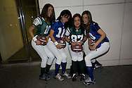 Four women dressed up as football players