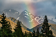 Rainbow at sunrise seen from Glentanner Park Centre Mount Cook, in the Southern Alps, Canterbury region, South Island, New Zealand.
