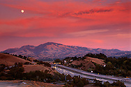 Moonrise at sunset over Mt. Diablo and freeway, Lafayette, Contra Costa County, CALIFORNIA