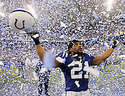 INDIANAPOLIS - JANUARY 21:  Free safety Bob Sanders #21 of the Indianapolis Colts celebrates while surrounded by a sea of blue and white confetti after the win against the New England Patriots during the 2006 AFC Championship game at the RCA Dome on January 21, 2007 in Indianapolis, Indiana. The Colts defeated the Pats 38-34. ©Paul Anthony Spinelli *** Local Caption *** Bob Sanders