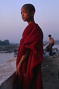 BURMA (Myanmar): Bagan (Pagan),. A novice Buddhist monk surveys the Irrawaddy River at sunset.