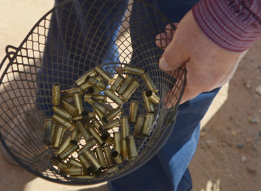 gbs072917q/RIO-WEST -- Shell casings are picked up during the Rio Grande Renegades Ladies Shoot  at the Albuquerque Shooting Range on Saturday, July 29, 2017. (Greg Sorber/Albuquerque Journal)