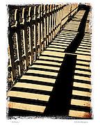 running fence along the sidewalk