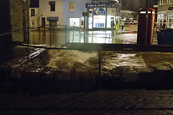 © Licensed to London News Pictures. 21/03/2013. Newlyn, UK. Flooding in Newlyn after the Newlyn Coombe river burst its banks. Newlyn has experienced 47mm of rainfall over the past 24 hours. Photo credit: Ashley Hugo/LNP