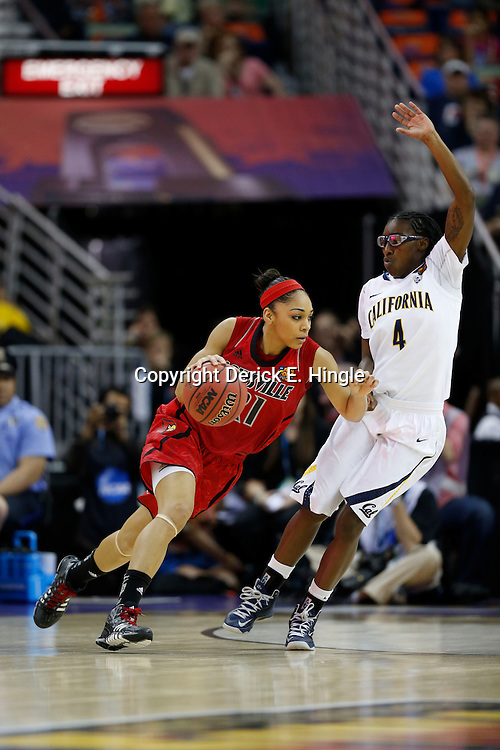 April 7, 2013; New Orleans, LA, USA; Louisville Cardinals guard Bria Smith (21) dribbles against California Golden Bears guard Eliza Pierre (4) during the first half in the semifinals during the 2013 NCAA womens Final Four at the New Orleans Arena. Mandatory Credit: Derick E. Hingle-USA TODAY Sports