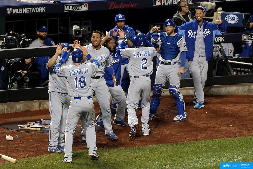 Salvador Perez, (center), and his Kansas City Royals team mates celebrate another run in the 12th inning during the New York Mets Vs Kansas City Royals, Game 5 of the MLB World Series at Citi Field, Queens, New York. USA. 1st November 2015. Photo Tim Clayton