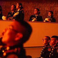 Members of the Grants High School Marines Junior Officer Reserve Training Corps watch a video presentation about their year during an awards ceremony at Grants High School Wednesday.
