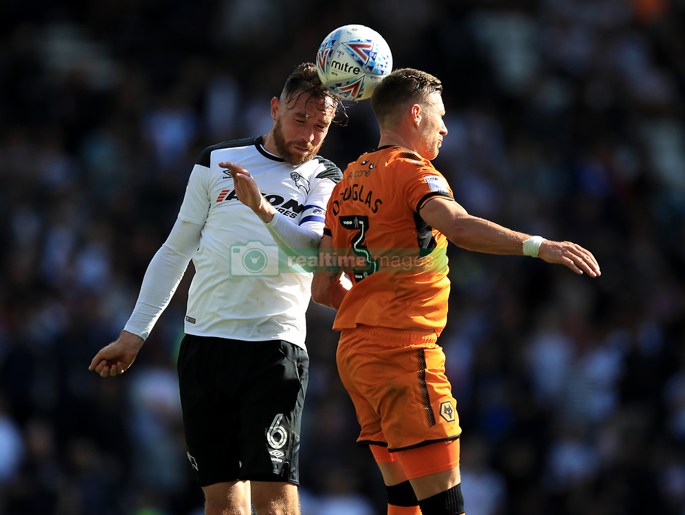 Derby County's Richard Keogh and Wolverhampton Wanderers' Barry Douglas battle for the ball