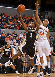 Wake Forest guard Brooke Thomas (1) shoots past Virginia guard Britnee Millner (12).  The #15 ranked Virginia Cavaliers defeated the Wake Forest Demon Deacons 77-59 in NCAA Women's Basketball at the John Paul Jones Arena on the Grounds of the University of Virginia in Charlottesville, VA on January 11, 2009.