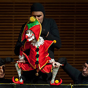May 5, 2012 - New York, NY : From left, puppeteers Eva Wiener, Philippe Nicolas Brunner, and Vladimir Fediakov of the Salzburg Marionette Theater perform Claude Debussy's 'La boîte à joujoux (The Toy Box) (1913),' featuring pianist András Schiff (not pictured), at Zankel Hall on Saturday evening. CREDIT: Karsten Moran for The New York Times