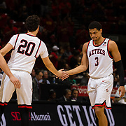 09 December 2017:  The San Diego State men's basketball team hosts the California Golden Bears Saturday afternoon. San Diego State Aztecs guard Trey Kell (3) is congratulated by teammate guard Jordan Schakel (20) as he walks off the court during a time out. The Aztecs trail 39-34 at halftime.<br /> www.sdsuaztecphotos.com