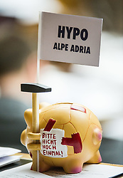 25.02.2014, Parlament, Wien, AUT, Parlament, 14. Nationalratssitzung, Sitzung des Nationalrates mit mit einer dringlichen Anfrage des Team Stronach an den Finanzminister zur Causa Hypo Alpe Adria. im Bild Sparschwein mit Hypo Alpe Adria Flagge // piggybank with Hypo flag during the 14th meeting of the National Council of austria, austrian parliament, Vienna, Austria on 2014/02/25, EXPA Pictures © 2014, PhotoCredit: EXPA/ Michael Gruber