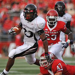Sep 7, 2009; Piscataway, NJ, USA; Cincinnati running back Isaiah Pead (23) avoids the tackle of Rutgers cornerback Patrick Kivlehan (47) during Rutgers' 47-15 loss to Cincinnati in NCAA college football at Rutgers Stadium.