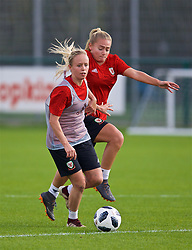 NEWPORT, WALES - Friday, October 5, 2018: Wales' Nadia Lawrence (L) and Charlie Estcourt (R) during a training session at Dragon Park. (Pic by David Rawcliffe/Propaganda)