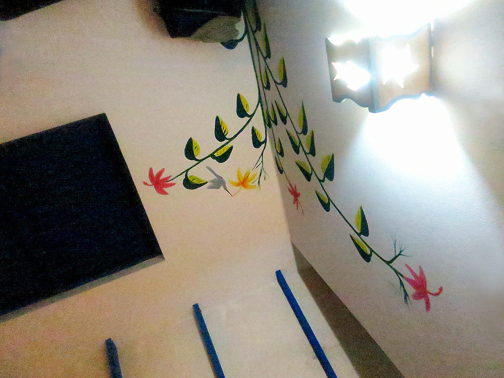 Painted decor on wall of cottage in Casas del Mar Neptunia, Las Terrenas, Semana Peninsula. Viewed from bed.