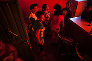 Sex workers dance in a night club of Kasanchs neighborhood. Those girls sells their body and alcohol in theese kind of bars.<br /> <br /> Addis Ababa, Ethiopia, 15-03-2013.<br /> <br /> To protect the identities of the recorded subjects names are omitted