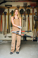 Portrait of a woman / small business owner in her landscaping equipment storage area...Model Release: 20070917_MR_A