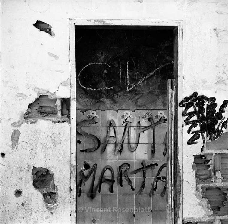 "Favela Santa Marta, Rio de Janeiro 2004: the writing CV (Comando Vermelho) marks the territory of this gang which controls a good part of Rio's  900 favelas. Big caliber bullet holes testify the violence of combats for the control of this favela located in the heart of Rio's nicest boroughs and at the foot of Cristo Redentor..The favela Santa Marta has been occupied by the Military Police since the beginning of 2009,  an attempt to put an end to 20 years of war between factions or between drug traffickers and the police. .Ii is in this favela  that Michael Jackson's video clip was filmed ""They don't care about us"" , in 1996, as well as Jo?o Moreira Salles & Katia Lund 's internationally awarded documentary  ""Noticias de uma Guerra Particular"" in 1999...? Vincent Rosenblatt / Agencia Olhares 