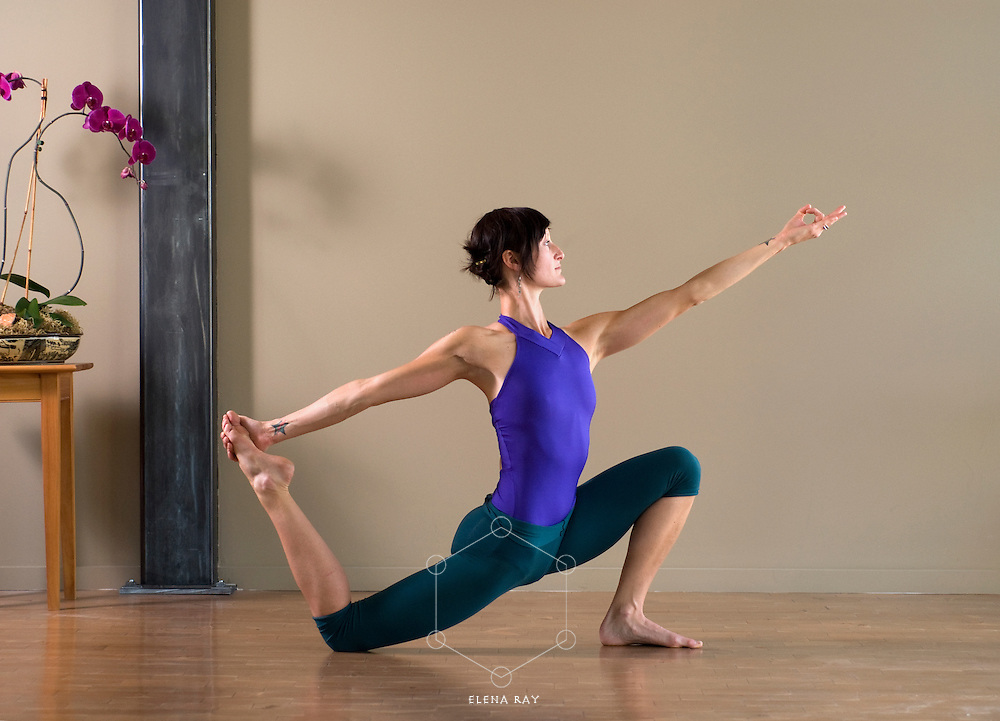 Dancer in yoga lunge with mudra.
