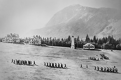 This undated photo of Fort William H. Seward in Haines, Alaska, shows the original fire hall tower on the grounds of the former U.S. Army post. To the right of the fire hall is the fort's guardhouse as soldier&rsquo;s march on the fort&rsquo;s parade field.<br /> <br /> After being absent from the historic Fort Seward skyline since approximately the 1930s, the 60-foot tower of the fort&rsquo;s fire hall has been restored to its original height. The building and tower, built around 1904 in Haines, Alaska, was shortened to approximately half its height in the 1930s for unknown reasons. The restoration included rebuilding a missing 35-foot section of the 60-foot tower whose purpose was to dry fire hoses. The tower restoration was completed by building its four sections on the ground and then hoisting those sections with a crane into place on top of each other.<br /> <br /> Through the years, the historic Fort Seward area, a former U.S. Army post, has been referred to as Fort William H. Seward, Chilkoot Barracks, and Port Chilkoot. The National Historic Landmarks listing record for the fort says that &quot;Fort Seward was the last of 11 military posts established in Alaska during the territory's gold rushes between 1897 and 1904. Founded for the purpose of preserving law and order among the gold seekers, the fort also provided a U.S. military presence in Alaska during boundary disputes with Canada. The only active military post in Alaska between 1925 and 1940, the fort was closed at the end of World War II.&rdquo; <br /> <br /> The bottom portion of the fire hall is being leased as commercial space. Due to fire code restrictions there is no public access to the upper portion of the tower. <br /> <br /> The fire hall was restored over a two-year period by owners Joanne Waterman and Phyllis Sage who also own the fort&rsquo;s original guardhouse located next door to the fire hall. That building, now known as the Alaska Guardhouse, is a bed and breakfast.
